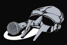 "MF DOOM / MF DOOM is a British-born American underground hip hop artist best known for his ""super villain"" stage persona and unique lyrics."