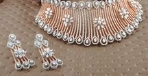 Rose Gold Jewelry / Feel romantic with a #blush warm hue of gold that beautifully showcases #diamonds & precious gemstones.  Shop an embellished selection of #designer #rosegold #jewelry featuring #earrings #pendantsets #engagementrings  #diamondnecklaces and more for #women . Go all #pink at: https://www.rajjewels.com/jewelry-jewellery.html?color=125