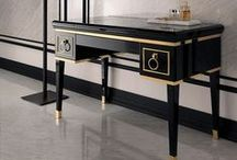 CONSOLE TABLE / /ˈkänˌsōl ˌtāb(ə)l/ (noun)      : a table supported by ornamented brackets, either movable or fixed against a wall.