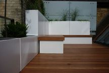Roof terrace 2 / SW London roof terrace with modular planters, hardwood deck & custom built bench seating with storage make for a minimal, clean look.