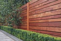 Slatted timber screens & fences / Modern screening options for covering existing fences & walls transforming a standard fence into a modern garden boundary.