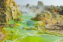 Hottest Place on Earth - Danakil - Ethiopia / The Afar or Danakil Depression, is not only the lowest point on the surface of the earth (120+ meters below sea level), but it is also the hottest inhabited place on the planet. As one of the most tectonically active areas in the world, the Danakil is an area of singular geological fascination. It is a strange lunar landscape, studded with active volcanoes, aromatic sulphur-caked hot springs, solidified black lava flows, and vast salt-encrusted basins.