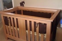 Island Crib / This island crib can be placed anywhere in the room and is convertible into a full size bed. It is made of reclaimed solid red oak and is finished with a honey stain and durable lacquer finish.
