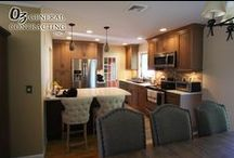 Transitional Kitchen August 2015 / Check out the before and after gallery of this Transitional Kitchen we completed in August 2015. The Kitchen felt very closed off and by removing the wall that leads into the dining room, we elevated that issue. We installed an island for more storage and to allow for an informal eating area. The shaker cabinet doors, with the unique color, compliment the quartz countertops and tile backsplash. This was truly a beautiful remodel.