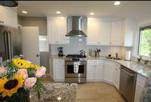 Transitional Kitchen 8-2015 for return customers / This is what we did. The goal was simple. Bring this kitchen into the 21st century while keeping the color scheme similar to the original. We installed white painted shaker cabinets, granite countertops, subway tile backsplash, stainless steel appliances, etc. The client, who is a return customer, opted for more of a transitional décor by using modern color cabinets and bar stools while using more traditional cabinet door styles, hardware, and lighting fixtures. How do you think we did?