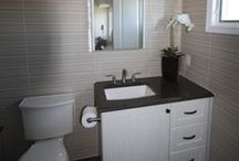 Modern Bathroom - Surf 2 / In this next gallery you will see that we've completely transformed this bathroom. The before and after pictures are really inspiring and they speak for themselves. The original space felt dark, small, and extremely dated. Once OZ was completed the renovation the space looked large, modern, and bright. The bathroom's accent wall tile really worked perfectly with the countertops and the custom shower door made the room feel larger. Visit ozgc.com for numerous other galleries we proudly display.