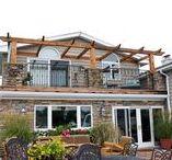 Mirotznik - Exterior and Outdoor Kitchen / A stunning stone exterior and outdoor kitchen to get you in the summer mood. #OZGC  #ACompanyYouCanTrust