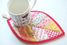 Potholders & Hotpads / by Sabine