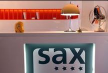 Hotel Sax Interior / 50´s, 60´s and 70´s period was typified by its freedom of design and the use of avant-guarde materials such as plastics and artificial leathers, which were made possible by the technologies of the time. Admire famous artworks by artists such as Andy Warhol and Victor Vasareli. Where else can you witness the distinctiveness of these unique pieces? Experience your afternoon tea lounging in an original Luigi Colani sofa or sit and enjoy a drink at the bar under famous Vernan Panton globe lamps.