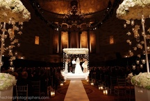 """Danielle & Gregg's Spectacular Wedding at The Gotham Hall   / Danielle is a very sweet bride who loves to have her wedding night to be very romantic, elegant and """"whimsical"""". She was the first bride to request to have her Chuppah hanging from the ceiling without any pole and decorated by hanging candles and orchid lay.  Two white seasonal bloom and orchid chandeliers with hanging orchids and hanging candles greeted the guests at the entrance of the ceremony aisle. It was one of the most romantic wedding nights that we, Tantawan Bloom, have ever done.  That"""