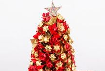 Christmas / If Edible Blooms is famous for one thing - it's delivering 'WOW' in the Festive Season... Imagine a Chocolate Christmas tree... Belgian chocolate foliage topped with a delicious freckle star, available in a variety of sizes and colours - no watering required!  Or perhaps luxurious champagne hamper or a Belgian chocolate wreath as the centre piece on your table is more your style...  There's a range of mouth watering gifts perfect for men and women just a few clicks away!