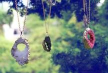The Crystal Caves Collection / These beautiful Geode Crystal Pendants come in a myriad of colors with Gold or Silver chains. Watch the light catch on the crystal formations at the center of each pendant, and delight at the beautiful mineral formations our planet can produce.