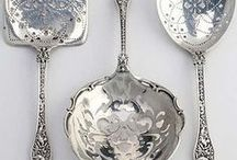 Silver cutlery and photograph frames