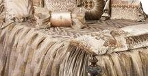 Luxury Bedding Angelique / The Angelique bedding collection is a subtle combination of velvet, animal patterns and shimmery metallic organza. The pillows are generously adorned with beading, Swarovski crystal trims, flat braids and ruffles. Luxury at it's finest! Our over sized bedding is designed to fit the larger beds of today with ample drop on both the duvet and the dust skirt. Angelique set includes: duvet, skirt, 3 ruffled euros, 2 brush fringe euros and 5 decorative pillows.