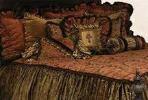 BELIZE LUXURY BEDDING / Belize Luxury Bedding Collection blends the warm tones of terracotta, caramel and bronze crushed velvet, silks, chenille, faux mink and a little animal print, embellished with beads, fringe, braids, and a beaded cross. Our over sized bedding is designed to fit the larger beds of today with ample drop on both the duvet and the dust skirt.  Belize set includes: duvet, skirt, 3 ruffled euros, 2 brush fringe euros and 5 decorative pillows.