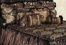 BRISTOL LUXURY BEDDING / Bristol luxury bedding collection combines rich chocolate, gold and crystal toned medallion print velvet with dark chocolate soft velvet. The pillows add textured animal fabrics and faux mink along with an assortment of braids, beaded trims, and Swarovski crystal pieces. Our over sized bedding is designed to fit the larger beds of today with ample drop on both the duvet and the dust skirt.  Bristol set includes: duvet, skirt, 3 ruffled euros, 2 brush fringe euros and 5 decorative pillows.
