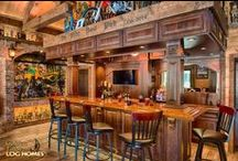Timber & Log Pub / This Pool Pub is a great place to entertain guests. In this case the owner uses it to display his family's many trophies and awards. Also on this property is the Shenandoah that is also pictured in our photo albums.  When custom and unique best describe what you are going to build and you want unlimited choices. This is the place to start whether you want a totally custom home, riding arena, pool pub, boat house, horse stable, trophy room, or lodge.