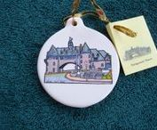 """Unique Handcrafted Ornaments RI Collection / """"Take a little bit of RI home with you."""" Hand painted & scissor cut porcelain & glass ornaments take three days to make. Variety of colors available with a hand painted design on one side. Glass ornaments ~ 2 5/8"""", flat porcelain ornaments ~ 3 1/2"""" and porcelain ball ornaments ~ 2 1/2"""". Custom designs and larger shatterproof ornaments also available.  See price list board. To order or get catalog contact artbysusievail@yahoo.com"""