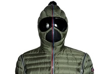 Fall-Winter 12/13 collection / AI–RIDERS ON THE STORM models of down- jacket for the FW 12-13 season which feature a uniquely engineered hood, that conceals the face, it has been designed to follow body movements perfectly, and fixed and interchangeable lenses that ensure excellent peripheral vision. The brand boasts two utility and design patents. / by AI RIDERS ON THE STORM