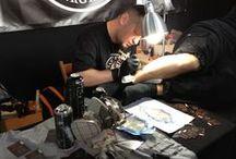 tattoo artists at work