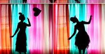 Sheer Curtain Backlit Backdrop / Layers of coloured sheer fabric - mirror theatrical curtain shape Heavily back lit Silhouette, walk through, camera move through -  B-roll