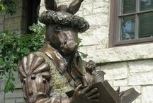 Geneva Public Library District / Special features of the Library include comfortable seating around our gas fireplace and a charming Literary Garden with a tall bronze statue of Nick Bottom from Shakespeare's A Midsummer's Night Dream.