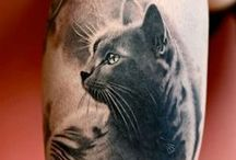Tat a tat tat, dog and cat / Pet related tattoos.