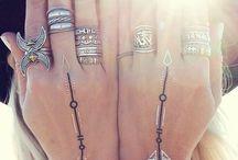 Jewellery and tatoo..