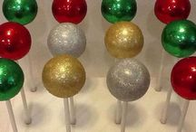 Cake - Cake Pops / Cake Pops come in many shapes, sizes, flavors, and colors. A Cake Pop is a small ball of cake covered in either chocolate or other candy coating and then placed onto a stick.