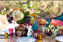 Bohemian Wedding Decor / What is Bohemian wedding decor?  Part Hippie, part Gypsy, part vintage with lots of rich colors. Candlesticks - usually brass or silver or lanterns or lots of votives; bright and rich colors of glass drinking goblets; bright and rich bottles for bud vases using flowers of all colors but in deep hues; fringe and rugs; pillows and poufs, brass, silver, mercury glass; and all in a relaxed vibe.