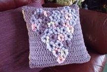 Cushion mad! / I like to crochet or knit cushion covers, they are relatively quick and small enough that I can take them with me when I go away. I love to use any yarn from cotton to furry stuff.