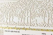 Orchards Heirloom Krtubah / We steal a glimpse of two deer resting in the shade of trees in the quiet of the afternoon. The pervasive tranquility in the Orchard Ketubah alludes to the marriage union as a restorative and strengthening bond.  We may leave the tumult of our lives behind and re-enter the orchard to seek companionship, a quiet moment and repose.