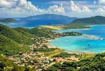 "Tortola, BVI / Tortola and the British Virgin Islands have a reputation among seasoned travelers as the creme de la creme of the Caribbean. It's also known as ""land of turtle doves,"" or Chocolate City. Tortola's terrain is varried, with mountain peaks covered with frangipani and sage on its southern coast, and its northern shores flaunt white sandy beaches, groves of succulent bananas and mangoes and groups of palm trees... a true gem of the British Virgin Islands."