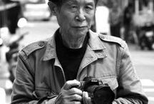 "photographs by Choi,Minsik.   (March 6, 1928 ~ February 12, 2013) / Choi Minsik is a South Korean documentary photographer He has been taking photographs of ""the people"" in Busan streets since 1957. His black/white photos capture the moments of people in a very vivid way.  Every single one of his photographs are portraits that are Koreans in Busan streets."