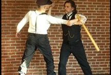 "Tech: Bartitsu / Bartitsu was created by William Barton-Wright, an English railroad engineer. Barton's work took him to Japan for three years where he was introduced to jujitsu. He studied the art at the school of Jigoro Kano. In 1899, Barton wrote an article entitled ""A New Art of Self Defense."" In it he set out his system of self defense. While bartitsu was based mainly on jujitsu, Barton explained that the system included boxing, kickboxing, and stick fighting."