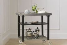 Anoon Drinkstrolley / Anoon acts as a unifying element to the home décor with an adaptability which means it can be used in any room either in a portable or static context. As well as a traditional drinks trolley or serving cart, use it as a supplementary table or shelving unit in the kitchen, dining room, hallway or home bar. With Anoon you can create a special atmosphere in the room and add an extravagance with plants, books, drinks and light.
