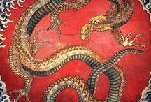 Dragonsinn.net / Selection of pages from Dragonsinn website. Features dragon history, culture, information, art, tattoos, poetry, and more.