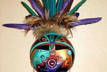 Feather Living Room / Feathered masks in a turquoise/tangerine room
