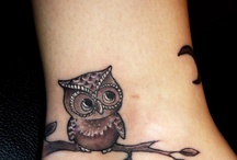 This mom ♡'s tats and piercings / by Jennifer Mabe