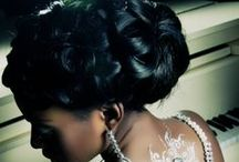 A Bride's Bridal Hair / A collection of formal and unique hairstyles to suit brides of all styles or races. Ideal bridal wedding hair consists of: 1. High and structured curly/wavy updos. For tiara placement. 2. Sideswept bangs. 3. Loosely curled tendrils. 4. Lower pinned bun in back of hair. For veil placement. / by Jynx Di Iettura