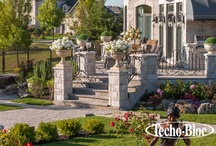 """Chateauesque / """"Rarely have Kings & Queens had the luxury of choosing their own empires, until now""""  Old world luxury is at the center of the Chateauesque look. The front of the home generally boasts a paved driveway, a beautifully shaped staircase and stone pillars that evoke a gated fortress. Multilevel pavilions flow from the back of the home onto a formal garden. When garden space is a priority, one alternative is a grand open pillared gallery framed with wrought-iron & masonry veneer fencing."""