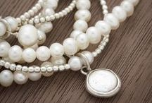 Pearls / Classic, pretty, unique, hip...we can't say enough about our pearl favorites. The Madison collection: equally worn at home, while strolling through Parisian streets, or perusing the local farmer's market. Instantly transforms even the simplest of attire to something memorable. Organic shapes combined with softly brushed silver.