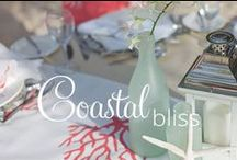 Coastal Bliss / A Contemporary Seaside Celebration Harness the essence of the coast in a sleek and elegant way with this collection. The natural beauty of the shore will complement you as you pledge your love to one another.