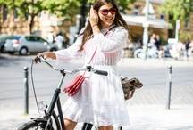 Fashionable Ladies with Cameras or on Bicycles