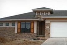Hunter Plan / The Hunter is a 3-car, 4-bedroom, 3-bath floor plan featuring a master walk-in closet and double sinks, covered front stoop and covered deck, main-level laundry, mud room, wet bar, and theater.