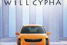 WiLL Cypha / The WiLL VC, later WiLL Cypha was produced from 2002 to 2005. It shared many of its mechanicals with the IST, Its styling developed themes seen in the Vitz/Yaris, but has a more angular look, a continuation of the short-lived WiLL Vi. Notable features are the rear lights placed level with the rear window and the distinctive headlights which have four lamps per side arranged vertically. The interior used a rounded theme, with items such as the door pulls and the central console being circular.