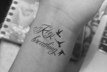 Tattoos!! / by Lara SpunkyandOutspoken