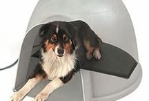 Dog House Heating / Now, you can keep your dog comfortable and cozy in their dog house during those cold winter nights. We have thermostatically controlled heaters for your dog house which are safe, simple to use and efficient. We have full line of outdoor heated dog pads that are ideal for use in a kennel, doghouse, garage, basement, porch, clinic or anywhere extra warmth is desired. Breeders, pet owners, and veterinarians have been using our heated dog beds to warm pets for decades. / by CozyWinters.com