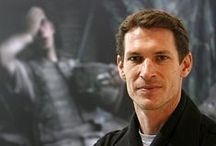 "Tim Hetherington / Timothy Alistair Telemachus ""Tim"" Hetherington (5 December 1970 – 20 April 2011) was a British-American photojournaliss He was best known for the documentary film Restrepo (2010), which he co-directed with Sebastian Junger; the film was nominated for an Academy Award for Best Documentary Feature in 2011. Hetherington was killed by shrapnel from either a mortar shell or an RPG fired by Libyan forces while covering the 2011 Libyan civil war."
