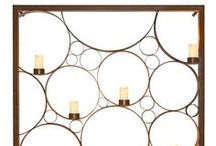 Candle Display by Entanglements Metal Art / Our range of candle displays is designed to enhance the play of light in a variety of setting. Our flowing, contemporary designs can create the perfect ambience in dining areas, can be used to reflect light across pools, or cast mesmerising shadows along walls.